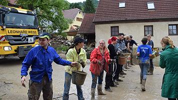Nach Unwetter: Aufräumarbeiten im zerstörten Braunsbach. Foto: Daerr/STUGGI.TV